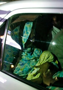 Sudanese woman Meriam Ibrahim holds her baby in a car shortly after her release in Khartoum