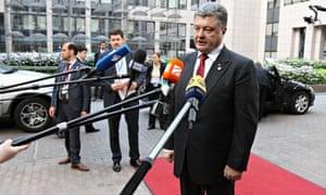 Petro Poroshenko talks to the media at the European Union summit in Brussels