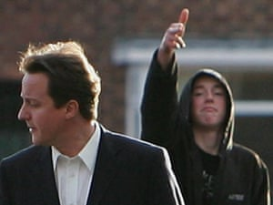 A youth gestures at David Cameron as he tours Wythenshawe in February 2007.