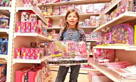 Little girl with pink toys