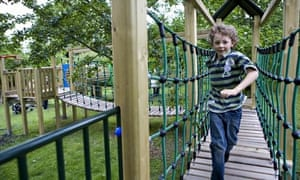 Child playing in the outdoor playground area at Hanbury Hall, Worcestershire