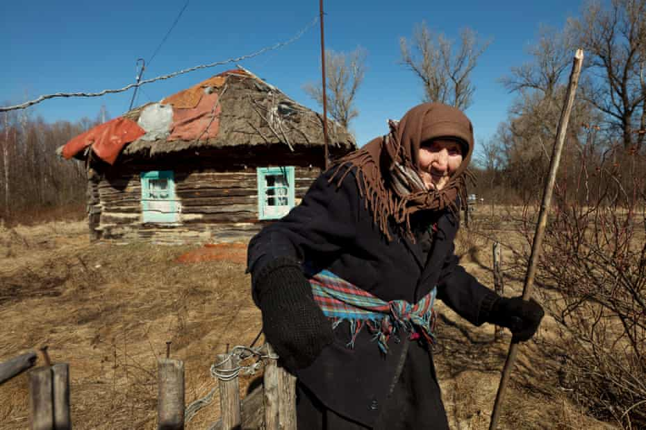 The Long Shadow of Chernobyl : 92year-old Kharytina Descha is one of the few elderly people who have returned to their village homes inside the Exclusion Zone.