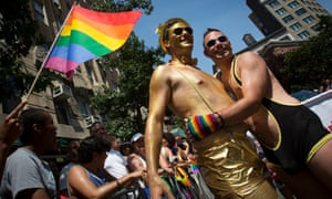Men hug as they take part in the annual Gay pride parade on Christopher Street in Manhattan.