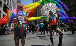 Participants in the Gay pride parade prepare to march in New York.