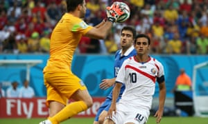 Greece's goalkeeper Orestis Karnezis (L) makes a save.