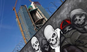 A graffiti is seen outside a fence surrounding the construction site for the new head quarters of the European Central Bank (ECB) in Frankfurt, March 6, 2013.
