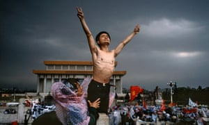 A student on hunger strike gestures in Tiananmen Square, 1989.