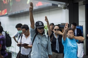 Protesters hold up the salute. The Thai army seized power in a coup that unseated a democratically elected government on May 22. Protest against the coup is illegal and the junta has threatened to arrest anyone who protests against it.