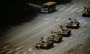A man stopping a column of tanks in Tiananmen Square, 5 June 1989.