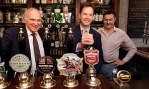 Anything Nigel Farage can do... Nick Clegg and Vince Cable show they are in touch with the people as they pull a pint of London Pride at the Queens Head Pub in Soho, London.