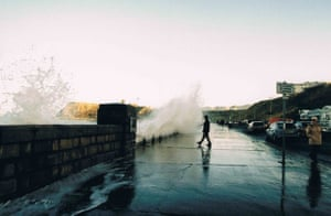 a person standing as a wave approaches