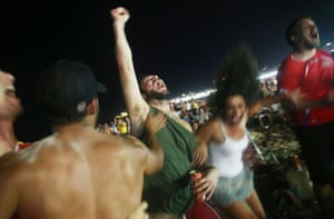 Costa Rica supporters celebrate before their shootout win over Greece on Copacabana Beach in Rio
