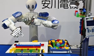 Yaskawa Electric's 'Motoman-SDA5D' manipulates Lego bricks at the International Robot Exhibition