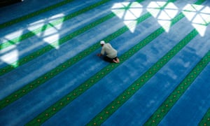 A man prays inside a mosque in Kuala Lumpur on the 2nd day of Ramadan