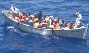 A lifeboat from the Italian frigate Grecale carries a group of migrants rescued in the Mediterranean Sea