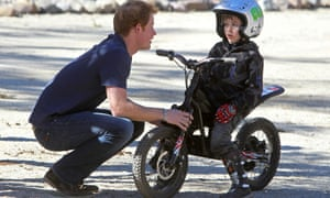 Britain's Prince Harry talking to a young boy at the Anteaya Outdoor Sports Center in Santiago, Chile
