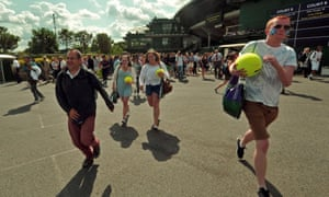 Andy Murray fans rush into the grounds as the gates are opened on day eight of the Wimbledon Championships