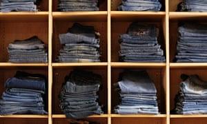 Denim jeans folded into shelves