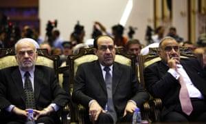 Iraq's Prime Minister Nouri al-Maliki, flanked by former prime minister Ibrahim al-Jaafari, left, and Iraq's Vice President Adel Abdul-Mahdi.