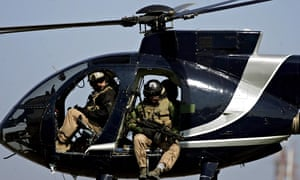 Blackwater security guards scan Baghdad from their helicopter