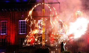 A pyrotechnician from Emergency Exit Arts lights a flaming depiction of William Shakespeare during a firework display at the Royal Shakespeare Company.