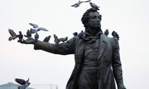 Birds perch on the monument of famous Russian poet Aleksander Pushkin, in front of the Russian Museum, in St Petersburg