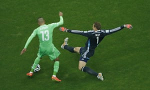 ...but Neuer gets back to tackle the Algerian forward.