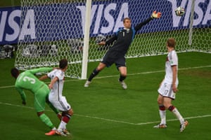 Germany's goalkeeper Manuel Neuer makes a save from Faouzi Ghoulam as Algeria press
