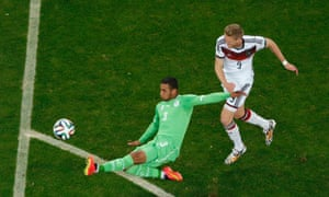 Algeria's Faouzi Ghoulam tackles Andre Schuerrle when he looked through on goal.