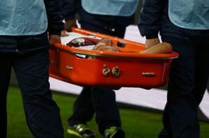 Shkodran Mustafi is stretchered off the field.