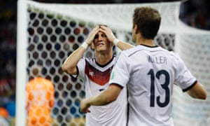 Germany's Bastian Schweinsteiger has his head in his hands after another missed chance.