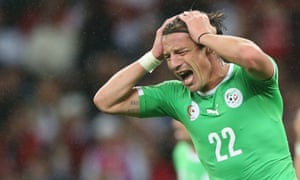 Mehdi Mostefa  of Algeria can't stand the pain.