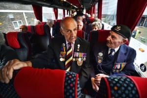 Second world war veterans Desert Rat Trooper, Fred Roberts (R) and Private Owen Butcher (L), sit in a bus in Basildon, Essex, before heading to France for the 70th anniversary of the D-day landings.
