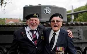 British Normandy Veterans (L) Joe Cattini, 91, and Denys Hunter, 90, who were both in the same unit of Herefordshire Yeomanry on Gold Beach on D-day and met up again for the first time in 70 years last night, share a joke as they visit the D-day Museum prior to catching a ferry to France in Portsmouth, England.
