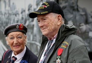 British Normandy veteran, Vera Hay, 92, who was a nurse in a field hospital shortly after D-day talks with fellow Legion d'Honneur recipient US veteran Jack Appel, 90, who landed at Omaha as a signaler with the US 1st Army as they visit the D-day Museum prior to catching a ferry to France in Portsmouth, England.
