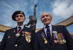 British second world war veterans, Ronnie Firth, 94, of the Royal Engineers 'Desert Rats' unit, (L) and Ernie Covill, 89, of the Royal Army Service Corps, (R) pose at the memorial monument at the US cemetery in Colleville-Sur-Mer, in Normandy, France.