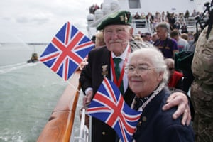 British Normandy veteran Pat Churchill, 90, who was with the 2nd Royal Marines Armoured Support Regiment which landed on Juno Beach on D-day, and his wife Karin, 84, catch a Brittany ferry to Caen to commemorate the 70th anniversary of D-day in Portsmouth, England.