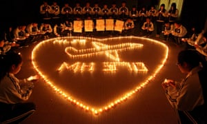 A candlelit vigil is held at a school in China for those who were on board MH370.