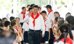 Chinese President Xi Jinping attends an initiation ceremony of Young Pioneers during his visit to Beijing Haidian national primary school.