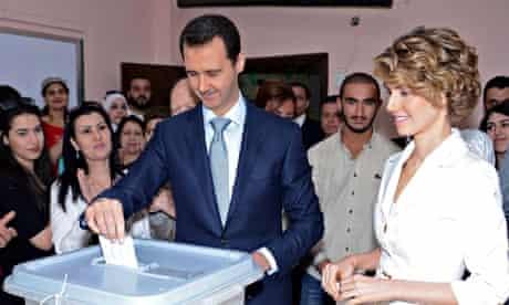 Bashar al-Assad and his wife Asma cast their votes