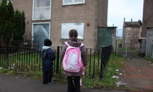 Children make their way home from school in the Easterhouse housing estate in Glasgow