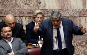 Leader of far-right Golden Dawn party deputy Nikos Michaloliakos (R), currently held on remand, addresses the Parliament before a vote that will decide whether he will be stripped of his immunity from prosecution, in Athens, Greece, 04 June 2014.