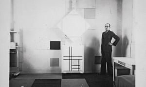 Mondrian in his studio in Paris, 1933 with Lozenge Composition with Four Yellow Lines (1933) and Composition with Double Lines and Yellow (1933).