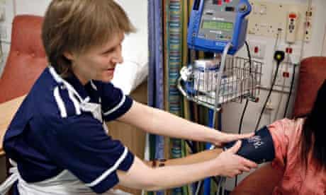 A nurse taking a patient's blood pressure at the Queen Elizabeth Hospital, Birmingham