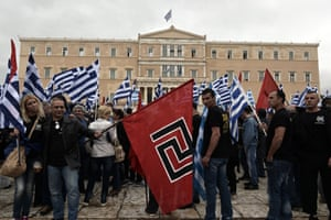 Supporters of the Golden Dawn ultra nationalist party  gather in front of the Greek parliament in Athens on June 4, 2014.