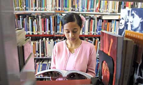 girl reading in the library
