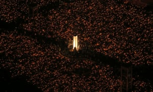 Tens of thousands of people attend a candlelight vigil at Victoria Park in Hong Kong.