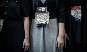 Students wear messages around their neck to commemorate China's 1989 Tiananmen Square events.