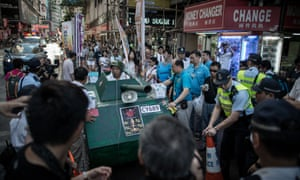 A tank replica is rolled in a street to commemorate China's 1989 Tiananmen Square crackdown.