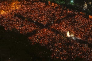 Tens of thousands of people participate in a candlelight vigil in Victoria Park.